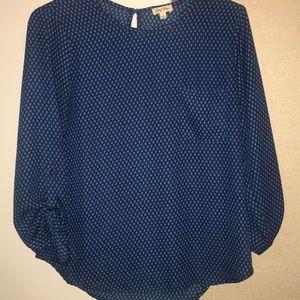 A drak blue blouse with little light blue diamonds